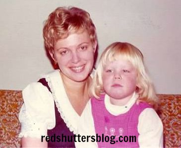 I have so many photos of my mom. I love this one because she looks so beautiful and because I remember the dress she's wearing. Yes, that's me in the photo, too. I'm perhaps about 4 years old and clearly not up for smiling.